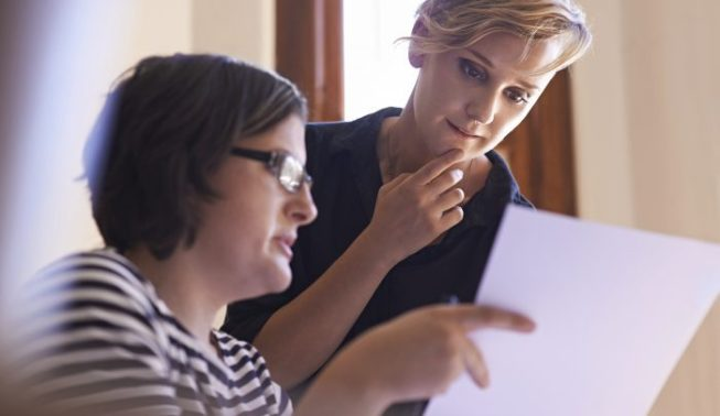A cropped shot of two women working together in a home office