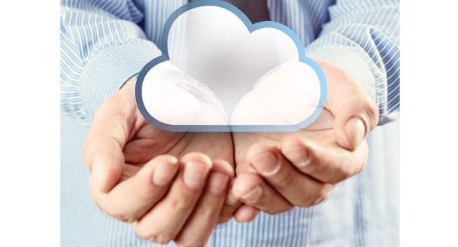 Cloud computing service. Cupped hands holding cloud symbol.