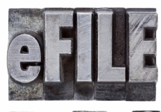 e-file taxes - tax concept - a collage of isolated words in vintage grunge metal letterpress type
