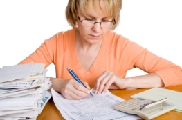 A woman filling out a income tax form
