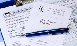 Prescription for healthcare reform and income tax form.