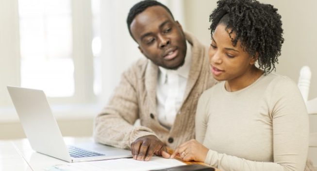 Black couple planning finance together