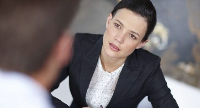 Cropped shot of an attractive businesswoman sitting with an unrecognisable person